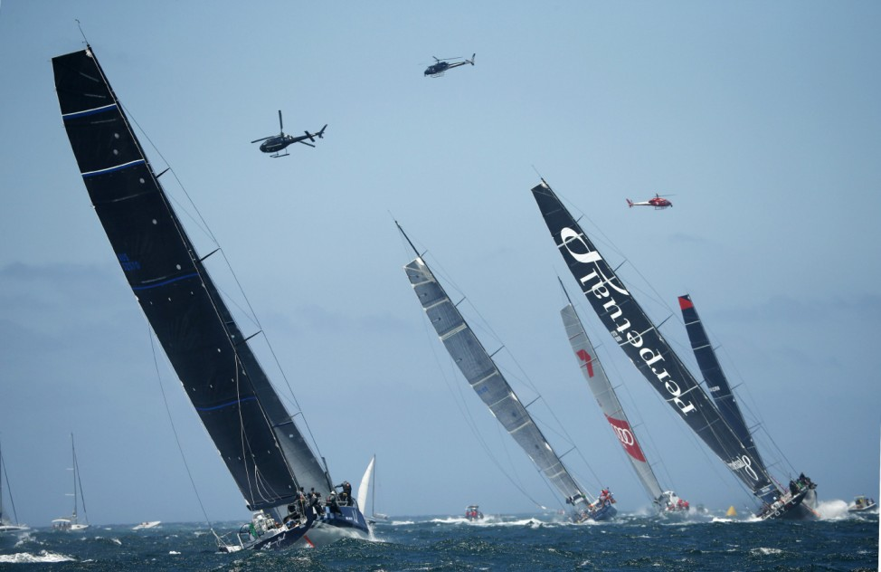The five lead boats head out into the Pacific Ocean at the start of the Sydney to Hobart Yacht Race