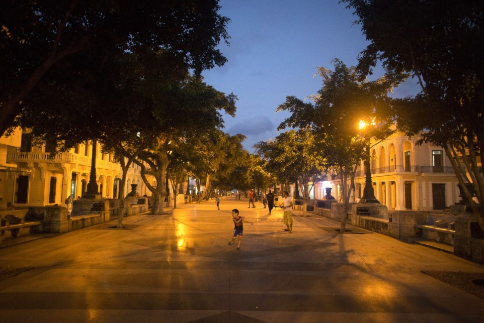 A child plays at the Prado Boulevard in downtown Havana