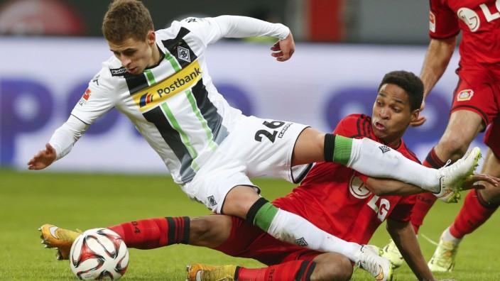 Bayer Leverkusen's Wendell tackles Hazard of Borussia Moenchengladbach during their German first division Bundesliga soccer match in Leverkusen