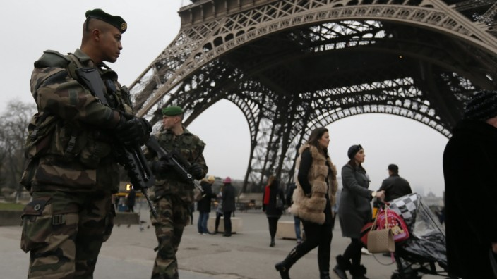 French soldiers patrol near the Eiffel Tower in Paris as part of the highest level of 'Vigipirate' security plan after a shooting at the Paris offices of Charlie Hebdo