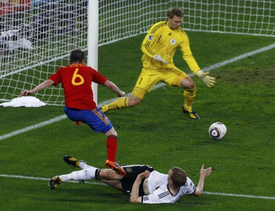 Germany's Mertesacker blocks Spain's Iniesta during their 2010 World Cup semi-final soccer match in Durban