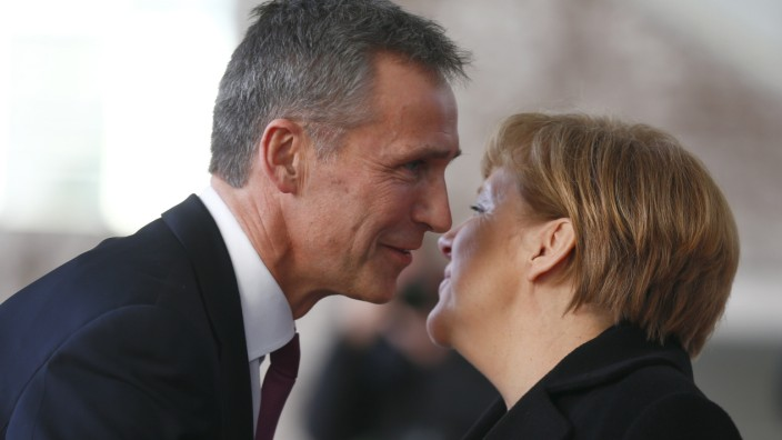 German Chancellor Merkel greets NATO Secretary General Stoltenberg at Chancellery in Berlin