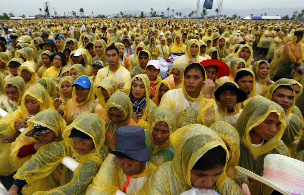 Catholic faithful attend a mass led by Pope Francis near Tacloban airport