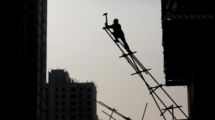 A Chinese migrant worker at a construction site in Beijing