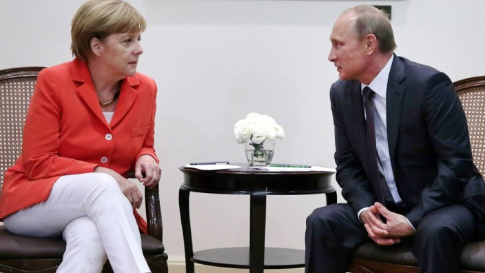 RIO DE JANEIRO BRAZIL JULY 13 2014 President of Russia Vladimir Putin R and German Chancellor