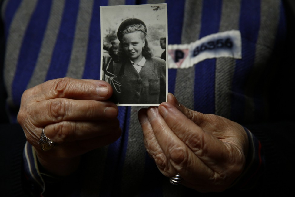 Auschwitz death camp survivor Jadwiga Bogucka holds a picture of herself from 1944 in Warsaw