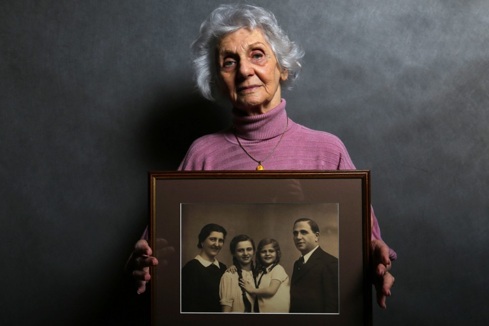 Auschwitz death camp survivor Eva Fahidi holds a picture of her family, who were all killed in the concentration camp during World War II