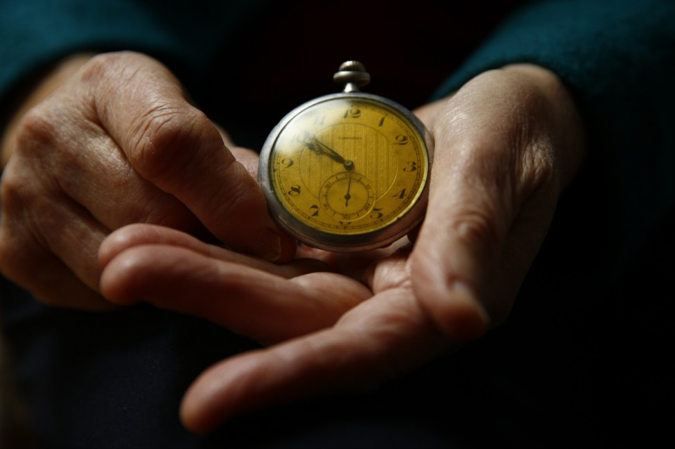 Auschwitz death camp survivor Elzbieta Sobczynska holds her father's watch as she poses for a portrait in Warsaw