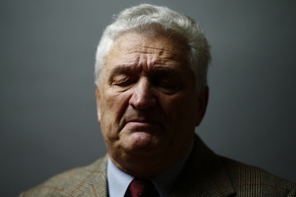Auschwitz death Camp survivor Jacek Nadolny poses for a portrait  in Warsaw