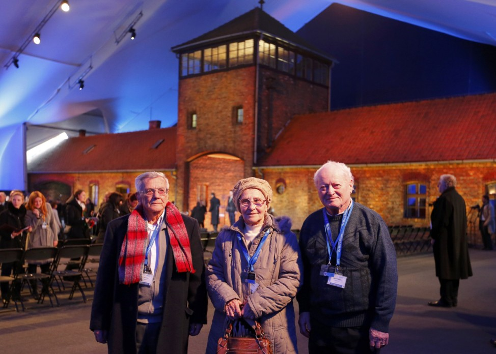 Survivors Forgacs, Rethazi and Varsanyi from Hungary pose for a picture inside a tent on the site of the former Nazi German concentration and extermination camp Auschwitz-Birkenau near Oswiecim