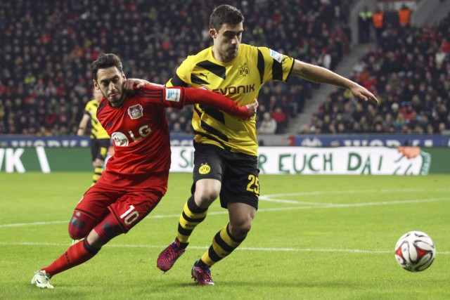 Borussia Dortmund's Sokratis challenges Bayer Leverkusen's Calhanoglui during their Bundesliga first division soccer match in Leverkusen
