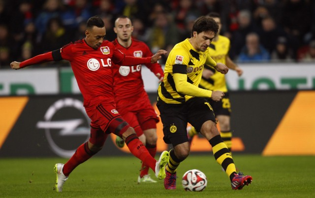 Borussia Dortmund's Hummels challenges with Bayer Leverkusen's Bellarabi during their Bundesliga first division soccer match in Leverkusen