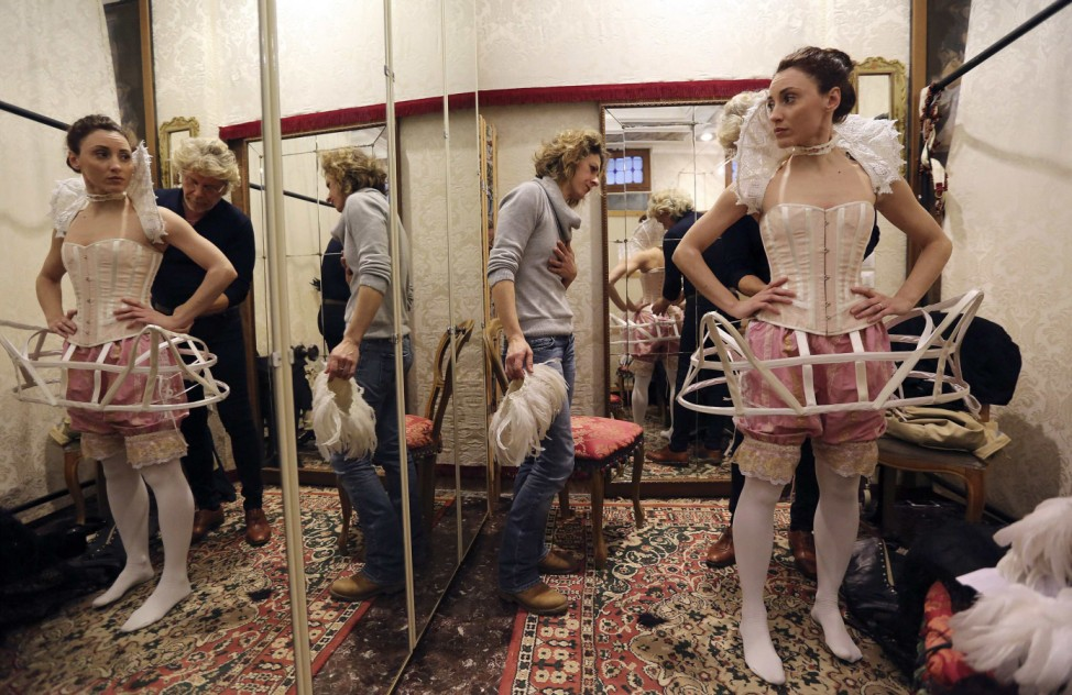 Costume designer Stefano Nicolao works on a creation in his atelier in downtown Venice