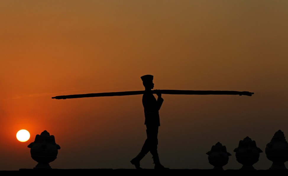 Sri Lanka Air Force personnel lowering national flag at sunset