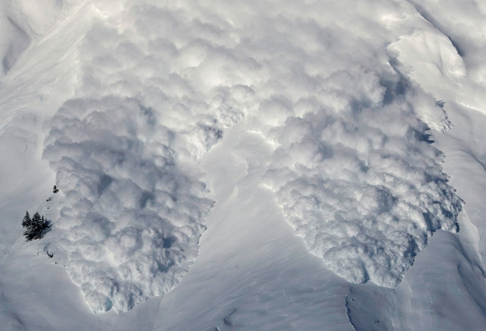 An artificially triggered avalanche thunders down a mountain side at the Vallee de la Sionne in Anzere