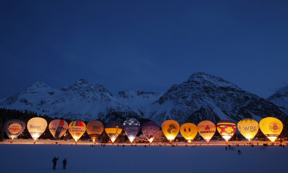 Hot air balloons are gathered on the Upper Lake for the traditional glooming during International Balloon Week in the Swiss alpine resort of Arosa
