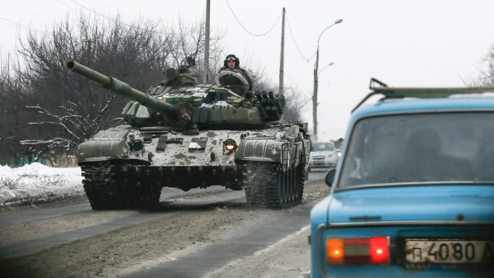 Pro-Russian separatists ride on a tank at the town of Khartsyzk, east of Donetsk