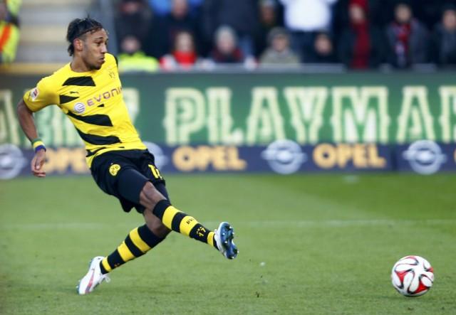 Borussia Dortmund's Aubameyang scores against SC Freiburg in Bundesliga soccer match in Freiburg