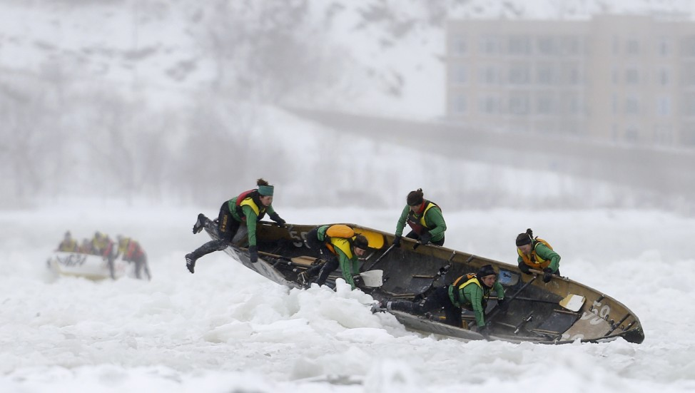 Team Volvo competes during the Quebec Winter Carnival ice canoe race on the St. Lawrence River in Quebec City
