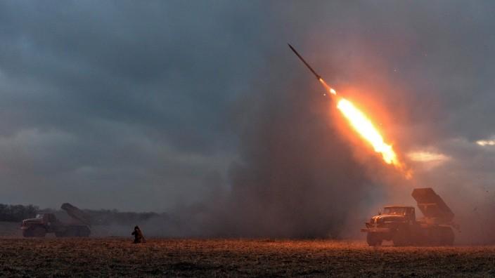 Ukrainian servicemen launch a Grad rocket towards pro-Russian separatist forces outside Debaltseve, eastern Ukraine