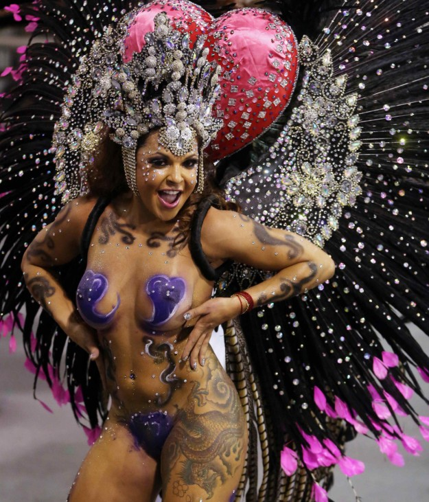 A reveller from the Vai-Vai Samba School takes part in a carnival at Anhembi Sambadrome in Sao Paulo