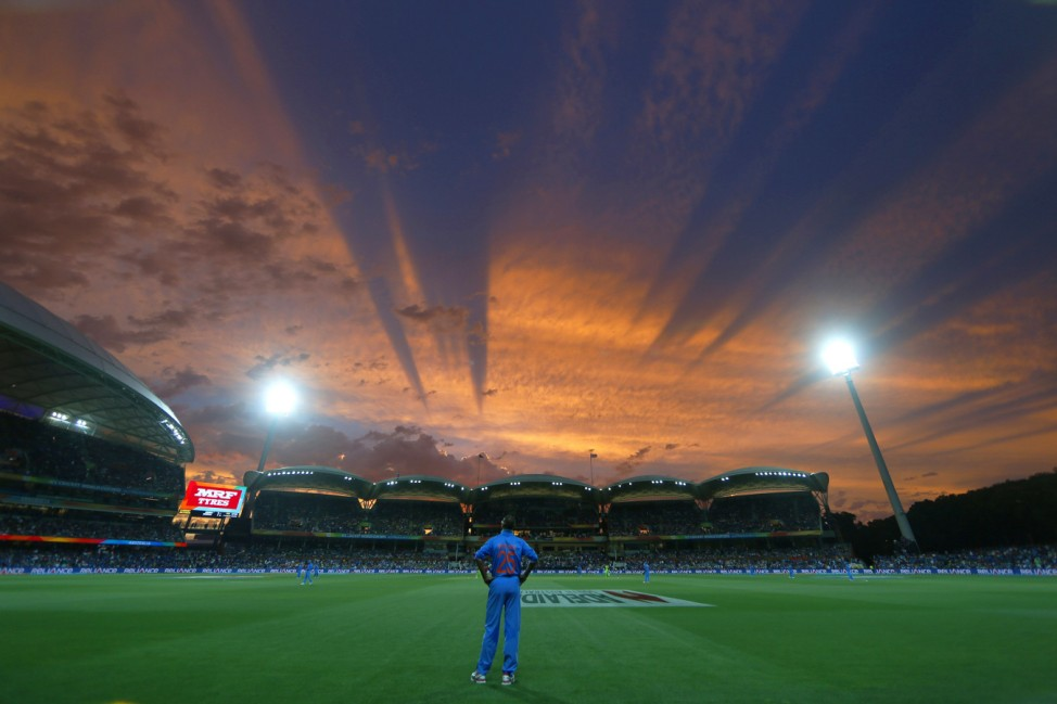 India's Shikhar Dhawan looks to the sky from his fielding position during sunset in their Cricket World Cup match against Pakistan in Adelaide