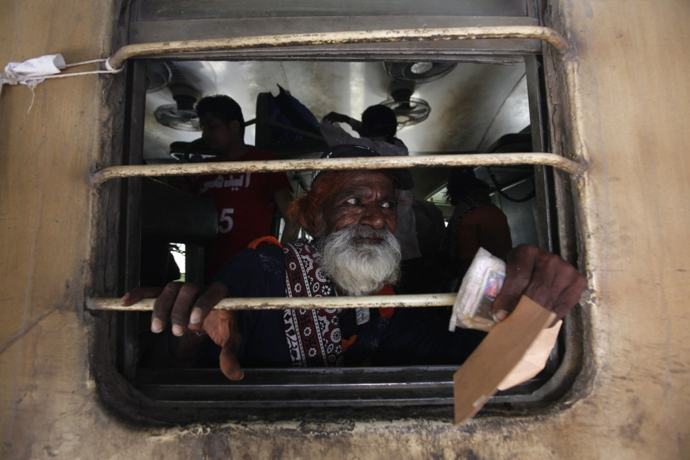 Fisherman from India looks out from a window of train, after his release with others from a prison, at Karachi's Cantonment railway station