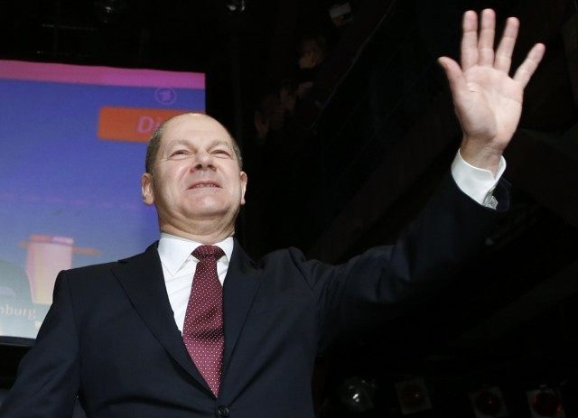 Social Democratic Party (SPD) top candidate, Hamburg Mayor Scholz waves to supporters after the first exit polls in a state election in Hamburg