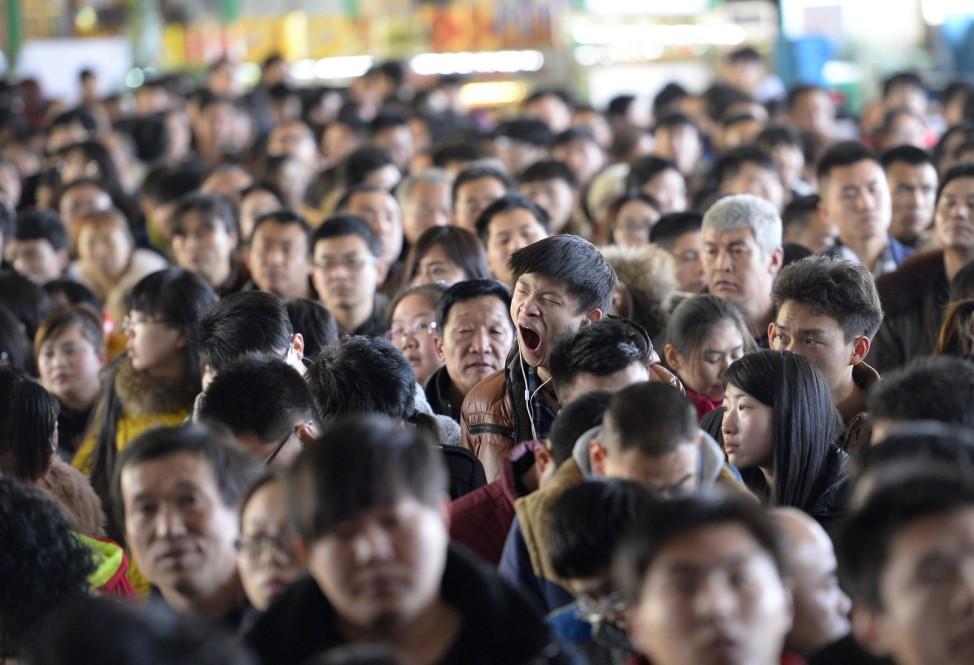 A man yawns at a railway station in Taiyuan