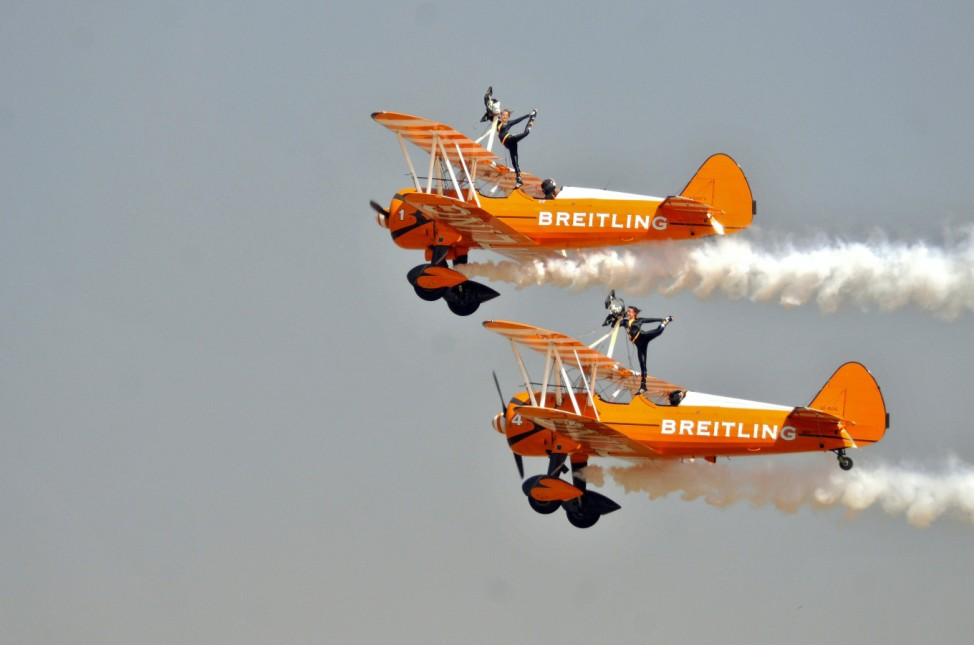 Members of the Breitling Wingwalkers perform during the inauguration ceremony of Aero India 2015 air show at Yelahanka air base in Bengaluru