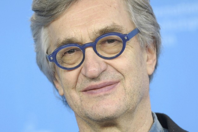 Director Wenders poses during a photocall at the 65th Berlinale International Film Festival in Berlin