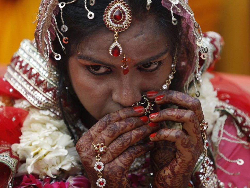 A bride gets ready during a mass wedding ceremony in Delhi