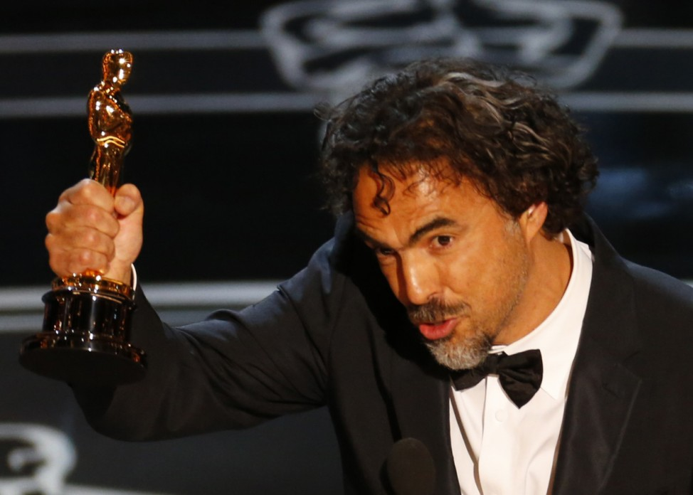 Director Alejandro Inarritu accepts the Oscar for Best Director for his film 'Birdman' at the 87th Academy Awards in Hollywood, California