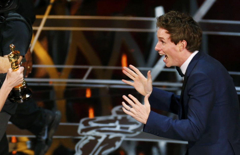 Actor Redmayne reacts as he takes the stage to accept the Oscar for best actor for his role in 'The Theory of Everything' during the 87th Academy Awards in Hollywood