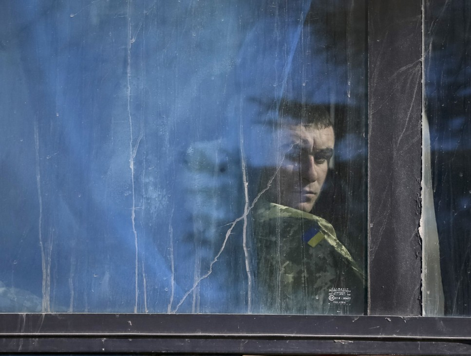 A Ukrainian serviceman, who fought in Debaltseve, is seen in a bus as he prepares to return home, in Artemivsk