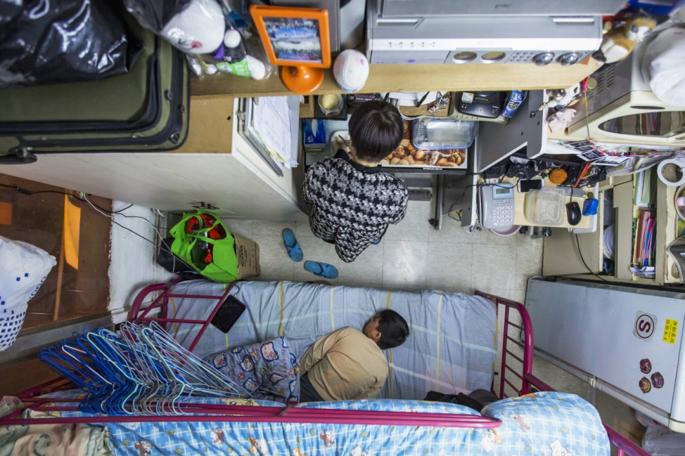 A woman and her son are seen in their 60-square-foot sub-divided flat in Hong Kong