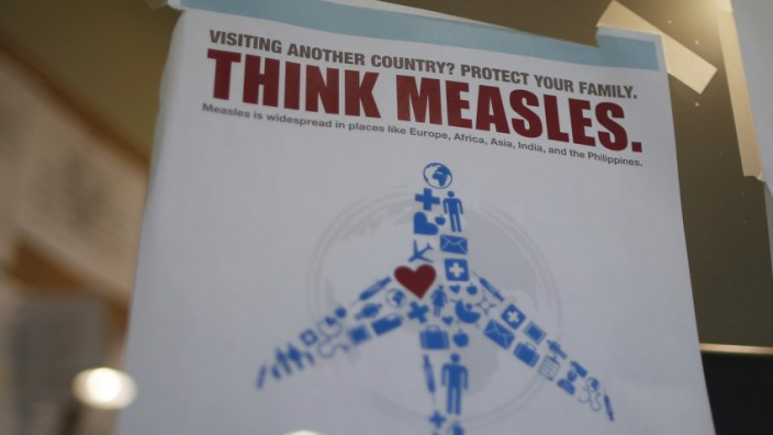 Measles poster is seen at Venice Family Clinic in Los Angeles