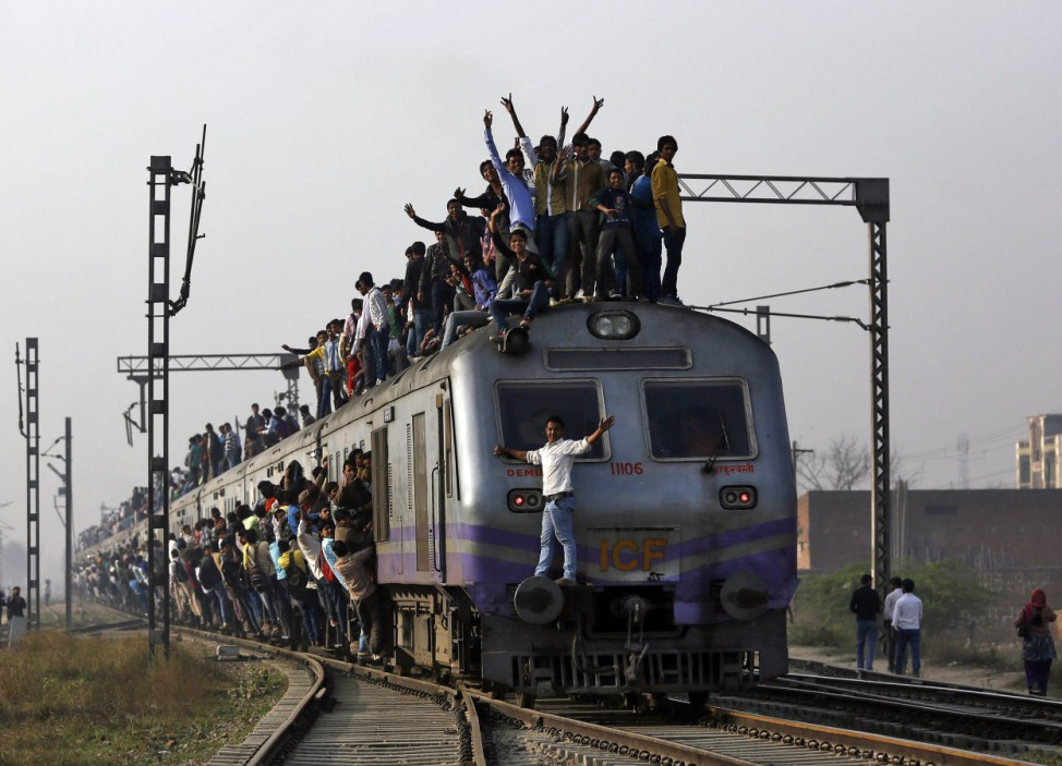 Passengers travel on an overcrowded train on the outskirts of New Delhi