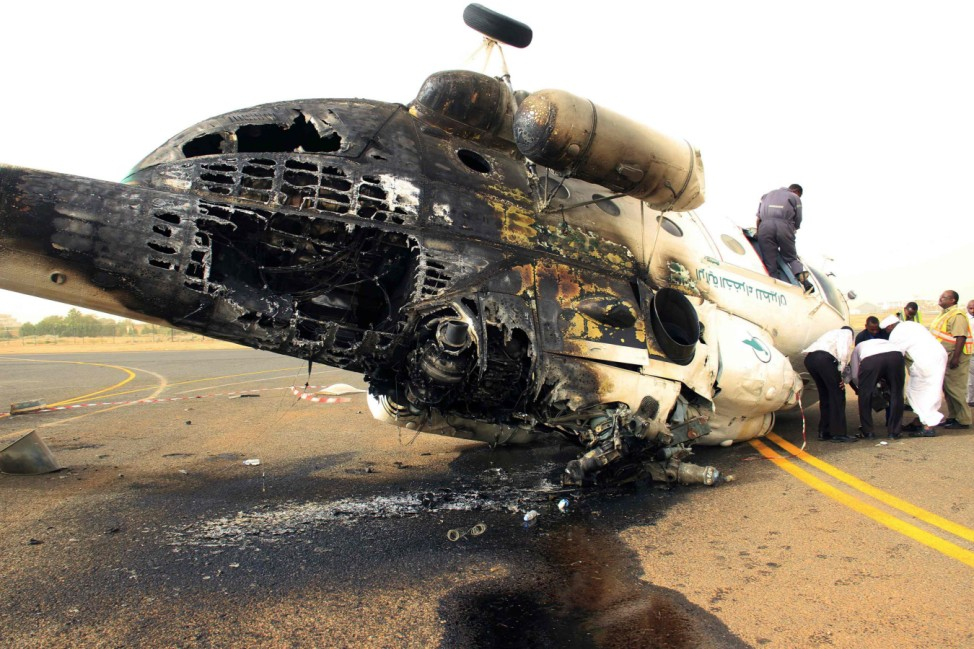A helicopter which caught fire is pictured at Khartoum airport