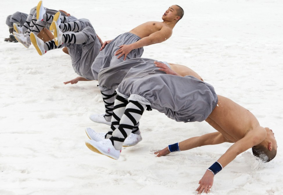 Monks practice martial arts in subzero temperatures after snow at Wanshou Temple in Changchun