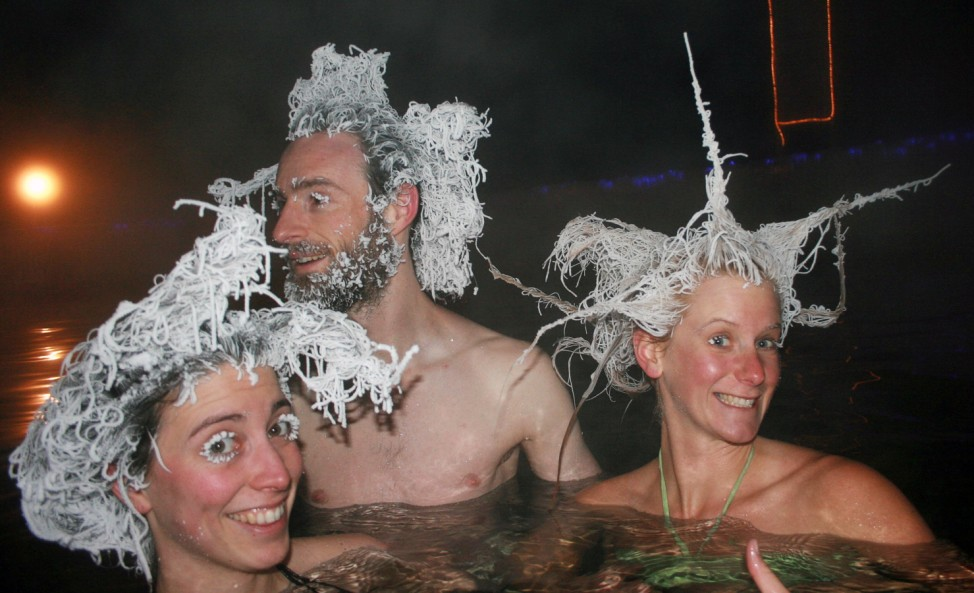Handout of bathers showing off frozen hair while bathing in a 40 degree Celsius pool in air temperatures of -30 C at Takhini Hot Springs in Whitehorse