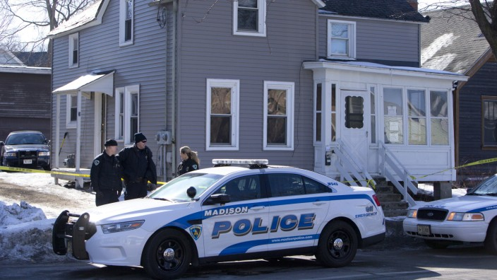 Madison Police investigate the scene of a police involved shooting late Friday at a home in Madison, Wis., on Saturday, March 7, 2015. A 19-year-old black man died Friday night after being shot by a p