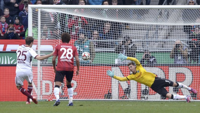Bayern Munich's Mueller scores penalty against Hannover 96's goalie Zieler during Bundesliga soccer match in Hanover