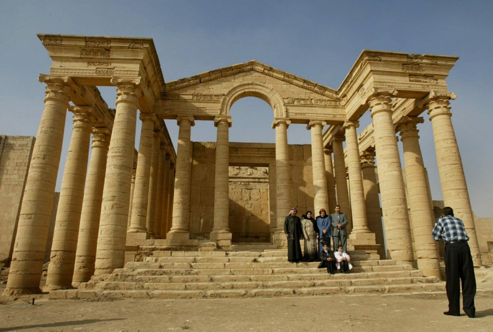 ARAB FOREIGNERS TAKE PICTURE IN FRONT OF TEMPLE IN HISTORIC CITY OF HATRA, 350 KM NORTH OF BAGHDAD
