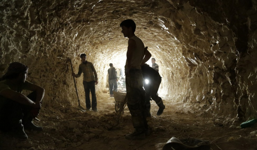 Rebel fighters dig caves in the mountains, to be used as shelters from the bombing of forces loyal to Syria's President Bashar al-Assad, in al-Latamna town, in the northern countryside of Hama