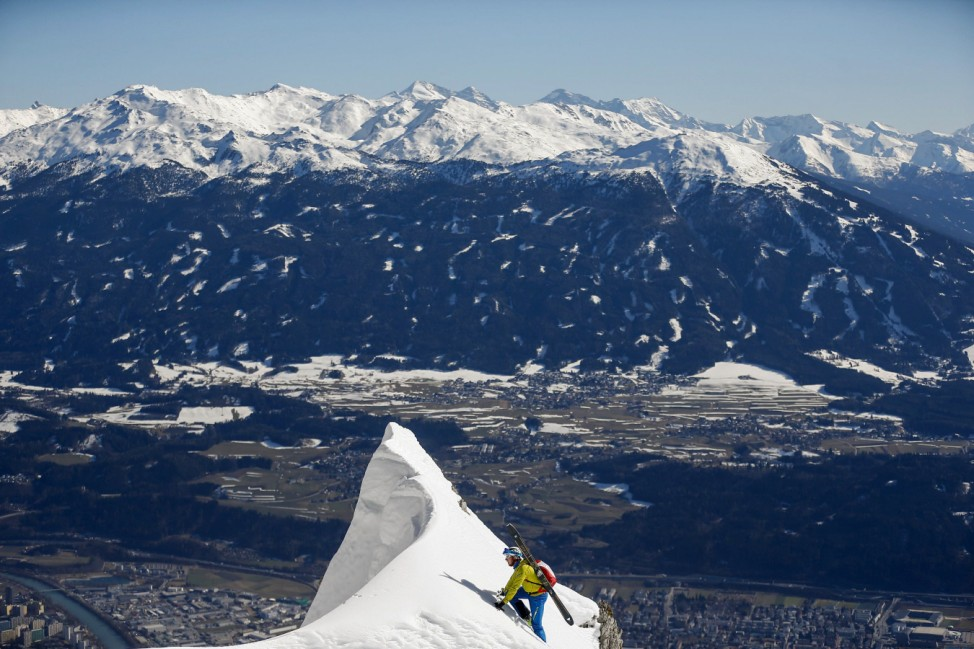A skier climbs up the summit on Seegrube mountain above the western Austrian city of Innsbruck