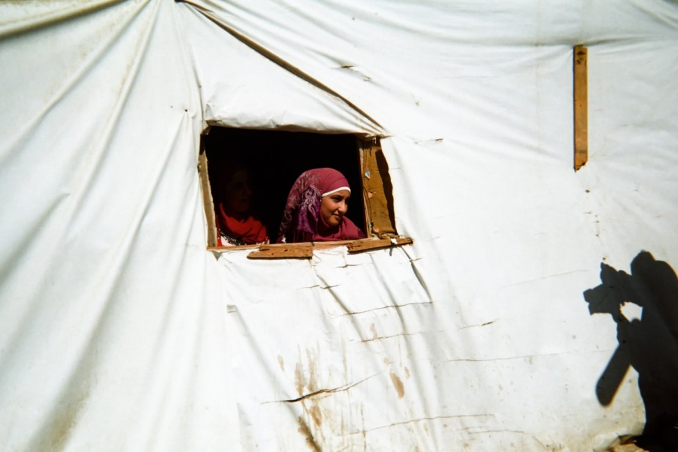 Abdel Kafi 11 years, lives in an informal settlement in Bekaa Valley. Abdel Kafi portrayed a Syrian refugee woman looking from the window of her tent. His shadow is reflecting on the tent. Abdel Kafi is one of the 500 children who participated in Lahza 2.