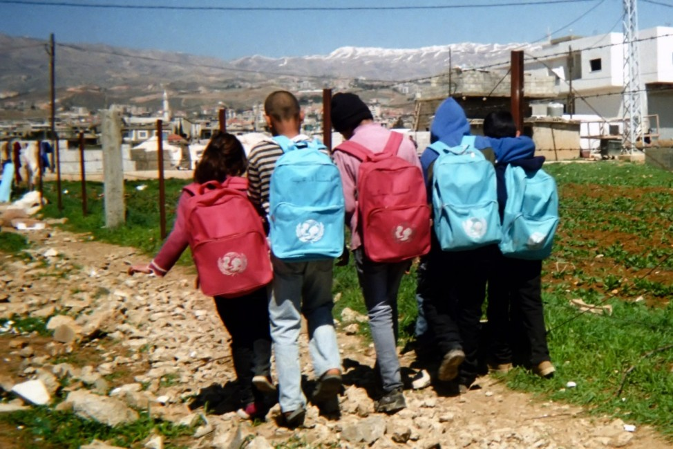 Ghazi, 10 years, from Al-Qusayr, lives in Saadnayel informal settlement in Bekaa Valley. Ghazi portrayed the back of five students wearing UNICEF bags while going to school.  He is one of 500 children participated in the UNICEF supported project âÄœLahza