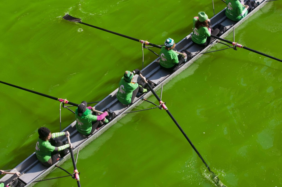 150315 CHICAGO March 15 2015 People row a boat in the green dyed Chicago River during the c