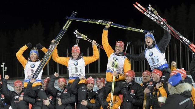 Germany's Lesser, Boehm, Peiffer and Schempp celebrate winning the men's relay competition at the IBU Biathlon World Championships in Kontiolahti